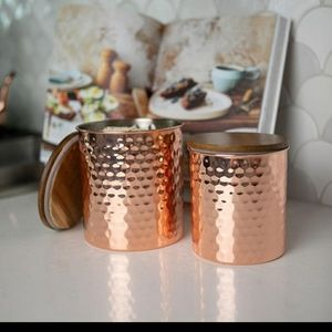 2 peice Copper Kitchen Canisters with wood lids.